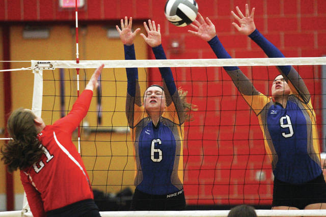 Russia's Jenna Cordonnier, center, and Laurissa Poling, right, block against Cedarville's Abigail Sheridan at Troy.