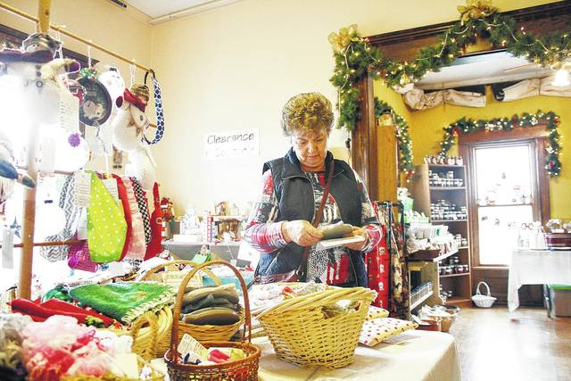 Jean Michael, of Sidney, attends the 2016 Angels in the Attic Craft Show at the William A. Ross Jr. Historical Center. This year's event will involve downtown Sidney with the first Shop Hop program.