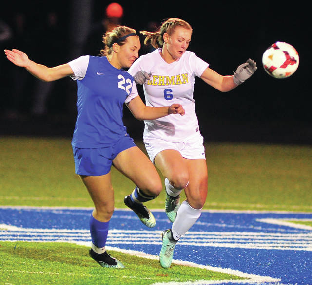 Lehman Catholic's Grace Monnin (right) battles for the ball with Madeira's Natalie Heisser during a Division III regional semifinal on Tuesday at Fairmont High School.