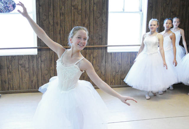 """Members of the Sidney Dance Company rehearse for """"Christmas of Yesteryear."""" They are, left to right, Mariana Kellner, 15, daughter of Ken and Jennifer Kellner; Cadence Patterson, 13, daughter of Amy Watercutter and Brad Peterson; Faith Clinton, 13, daughter of Jill and Eric Clinton, all of Sidney; and Katie Kogge, 13, daughter of Sheri and Marc Kogge, of Minster."""