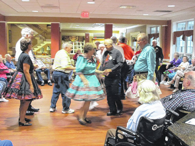 Square dancers of the St. Marys Tri-Squares perform at Elmwood Assisted Living in New Bremen, recently. Caller Ed Heuker and his wife, Sue, led two squares, dancing at the same time. Dancers were Belinda and Rick Nagel, Lola and Paul Leasor, Debby and Barry Muskus, Tom Binley, Marlene Hitchen, Carolyn and Bill Slemmons, Larry Scott, Yvonne Strohmeyer, Betty and Carl Kremer and Marjean and Jerry Dwenger.