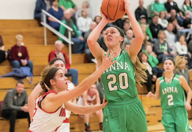 Anna's Macey Huelskamp shoots as New Knoxville's Erin Scott defends during a nonconference game at New Knoxville on Thursday. Huelskamp and Ella Doseck led the Rockets with 10 points each.