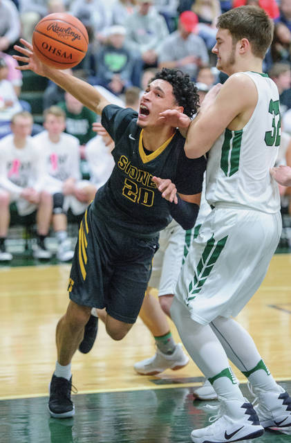 Sidney junior guard Andre Gordon loses the ball while colliding with Greenville's Noah VanHorn during a Greater Western Ohio Conference American North game on Friday. Gordon went over 1,000 career points on Friday.