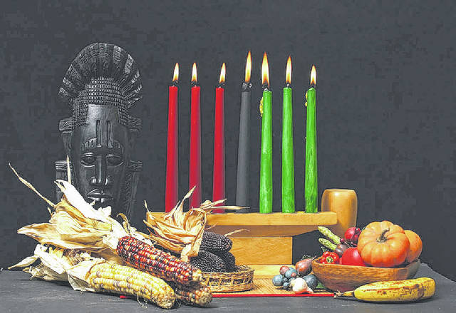 The kinara, a seven-branched candleholder, sits among several symbols of Kwanzaa, a weeklong African-American cultural and historical celebration that began on Tuesday.