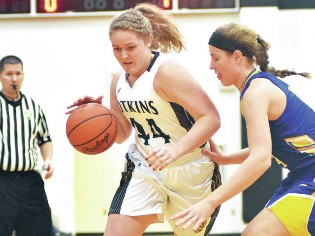 Botkins' Grace Homan, left, drives against Russia's Laurissa Poling at Botkins Thursday.