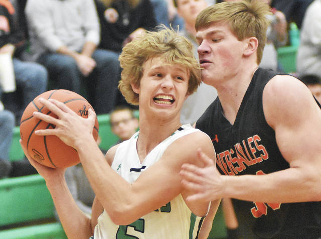 Anna's Wyatt Bensman drives against Versailles' AJ Ahrens during a nonconference game Wednesday at Anna. Bensman led Anna with 29 points.