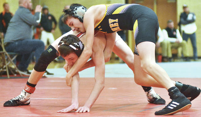 Wrestling at 113 pounds, Sidney's Grant Fair, right, works to control the arms of Milton Union's Aaron Beckman at Butler on Wednesday during the Greater Miami Valley Wrestling Association Holiday Tournament.