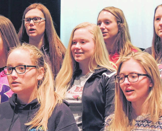 Depending on the song, Sara Parker, center, sings soprano or alto in the Christmas concert Monday night at New Bremen High School.