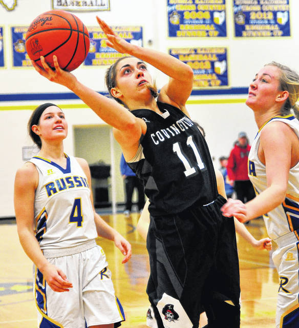 Covington's Samantha Whiteman puts up a shot against Russia's Cameo Wilson on Tuesday.
