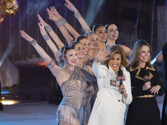 """Savannah Guthrie, right, and Hoda Kotb appear with the Rockettes during the 85th annual Rockefeller Center Christmas Tree lighting ceremony on Nov. 29 in New York. NBC News opened the new year by appointing Kotb as co-anchor of the """"Today"""" show's first two hours with Guthrie, replacing Matt Lauer following his firing on sexual misconduct charges in late November."""