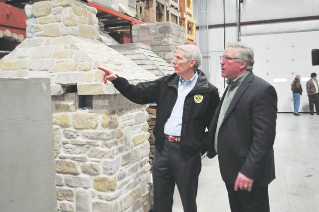 U.S. Senator Rob Portman toured one of the warehouses at Bruns General Contracting with owner Steve Bruns on Monday. Portman is visiting businesses across that state to talk about the recent tax reform bill and the savings businesses and individuals could expect to see.