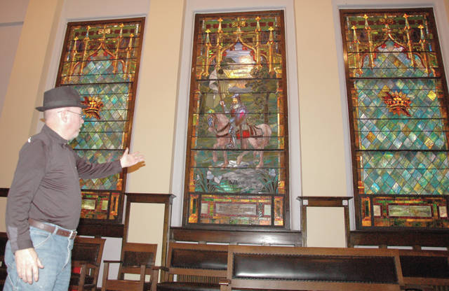 Lodge Master Bruce Ball describes one of the lodge's stained glass fixtures, which depicts lodge founder Asa Coleman, at the lodge's Main Street location, Wednesday, in Troy.