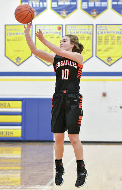 Versailles senior guard Kami McEldowney shoots a 3-pointer during a nonconference game at Russa on Saturday. Bryant Billing | Sidney Daily News