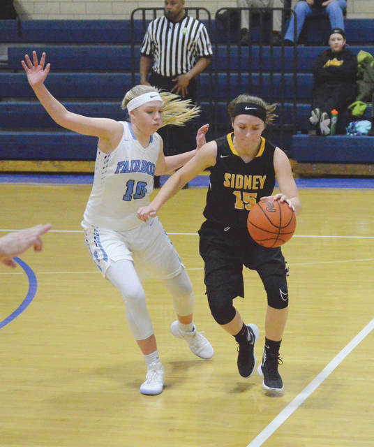 Sidney's Alina Kindle, right, dribbles with pressure from Fairborn's Evelyn Oktavec in the first half of a game on Wednesday Baker Middle School in Fairborn. Oktavec led Fairborn with a game-high 23 points and Kindle led the Yellow Jackets with 15.