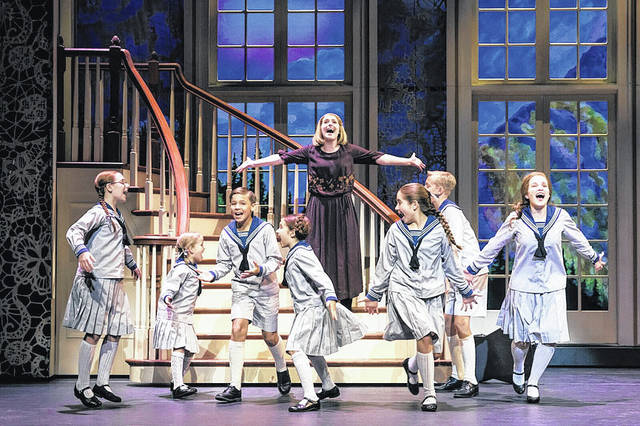 """Jill-Christine Wiley, as Maria, romps with the von Trapp children in a scene from """"The Sound of Music."""" The beloved musical will perform in Dayton at the Schuster Center beginning Feb. 13."""