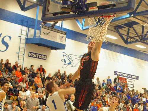 Versailles' Justin Ahrens scores during a boys basketball game against Franklin Monroe on Saturday in Pitsburg. Ahrens passed his older brother Kyle, a Michigan State University basketball player, for second on Versailles' all-time scoring list in the win against FM.