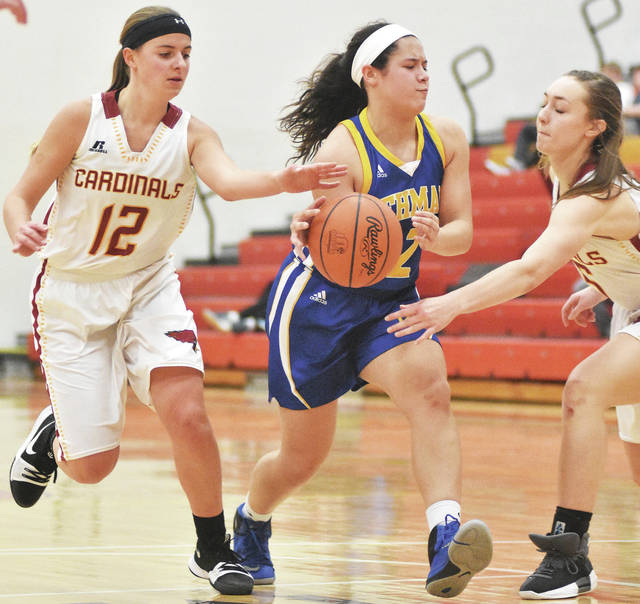 Lehman's Lauren McFarland, center, is converged on on by New Bremen's Hanna Tenkman, left, and Macy Puthoff during a nonconference at New Bremen on Saturday.
