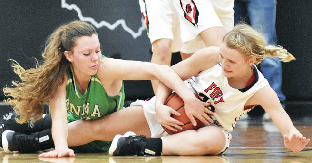 Anna's Macey Huelskamp, left, looks to get the ball from Fort Loramie's Hattie Meyer during a Shelby County Athletic League game Thursday. The Redskins stay undefeated in the SCAL with a 32-29 win.