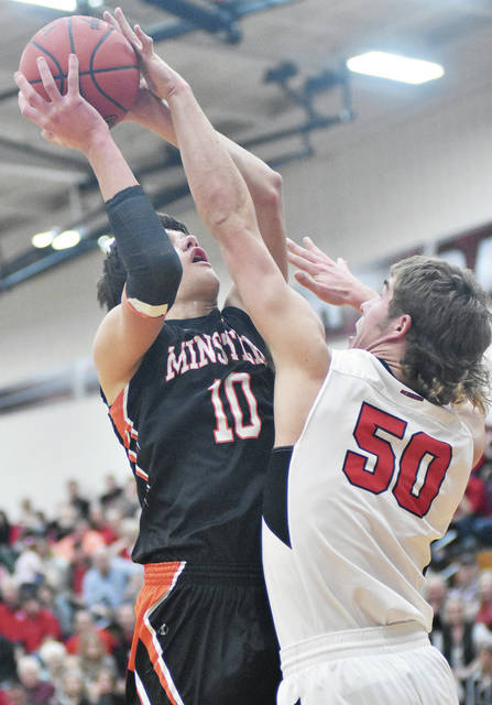 Minster's Cody Wall shoots as Fort Loramie's Tyler Siegel defends during a nonconference game at Fort Loramie on Saturday.