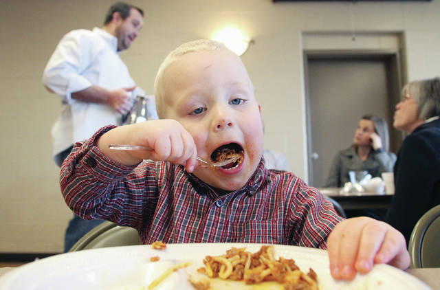 Elijah Watercutter, 2, of Anna, son of Rob and Mary Watercutter, takes a bite of spaghetti at the Knights of St. John Commandery #300 Smokehouse Spaghetti benefit. The fundraiser was held at St. Michael's Hall Sunday, Jan. 28. Knights of St. John Commandery is a Catholic organization that donates to local organizations.