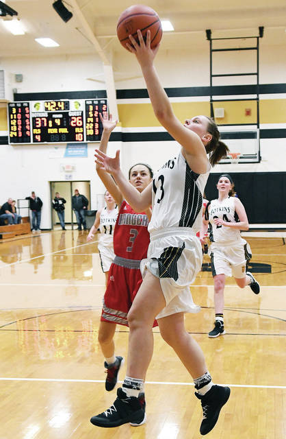 Botkins' Paige Lane drives past New Knoxville's Jacklyn Leffel during a nonconference game on Monday at Botkins.
