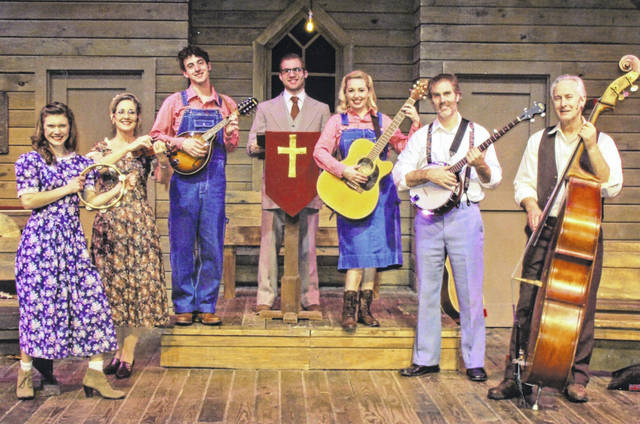 """Marie Putko as June, left to right, Becky Barrett-Jones as Vera, Cory Clark as Dennis, Matthew Staley as the Rev. Oglethorpe, Emily Carlstrom as Denise, Brick Waltermire as Burl and Chris Kramer as Stanley perform a song in """"Smoke on the Mountain"""" at La Comedia Dinner Theatre in Springboro."""
