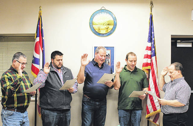 Newly elected and reelected Versailles Village Council Members were sworn in by Mayor Jeff Subler (far right) Wednesday night. Shown taking the oath, from left, are Mike Berger, Cory Griesdorn, Kent Paulus, and Lance Steinbrunner.