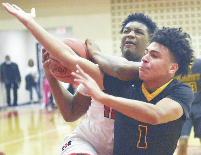 Sidney's Darren Taborn, right, tries to get the ball away from Trotwood's Malachi Mathews during a Greater Western Ohio Conference crossover game on Friday at Trotwood.