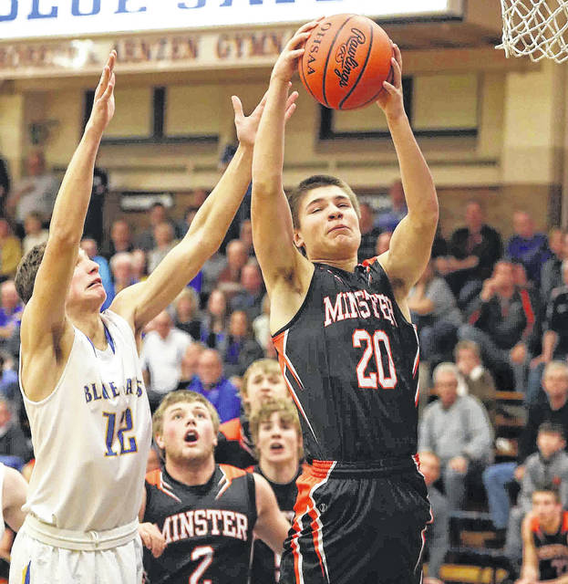 Minster's Jack Heitbrink, right, and Delphos St. John's Brady Parrish battle for a rebound during a MAC game on Jan. 5. Minster plays Franklin Monroe on Monday in Flyin' to the Hoop.