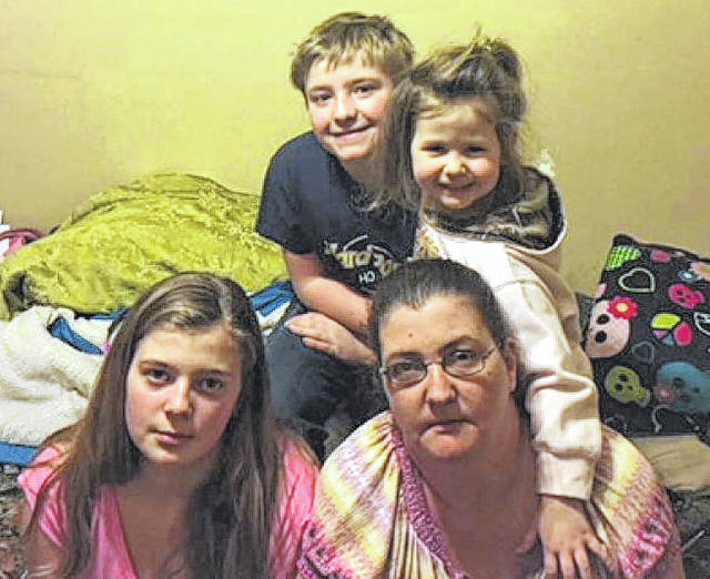 """Christina """"Christi"""" Haag, of Greenville, the mother in this photo, lost her life in a house fire on Saturday. All three children, Brianna, Trey and Courtney, and Christi's boyfriend, Michael Osborne, suffered injuries from the fire."""