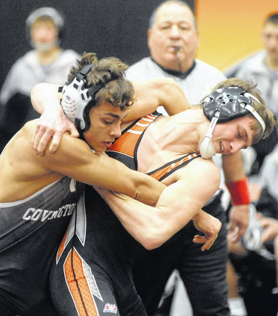 Jacob Poling of Versailles works for a takedown against Covington's Taylen Viney in the Division III state team duals on Wednesday at Versailles High School.