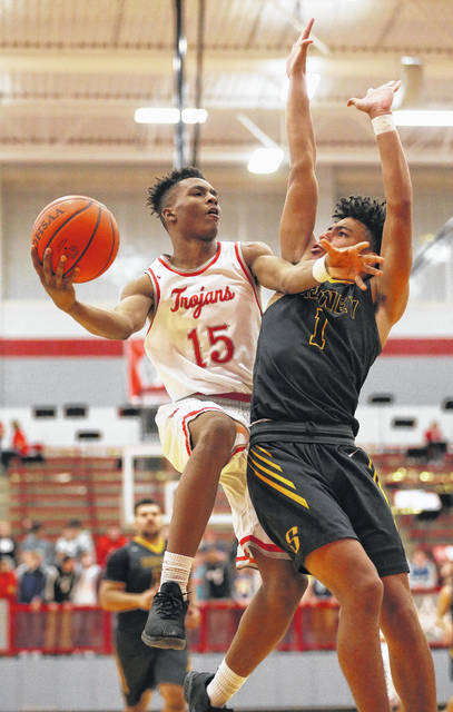 Troy's Caillou Monroe drives to the basket against Sidney's Darren Taborn during a game on Feb. 3. The Yellow Jackets and Trojans will meet for a third time this season on Friday in a sectional quarterfinal at Trotwood.