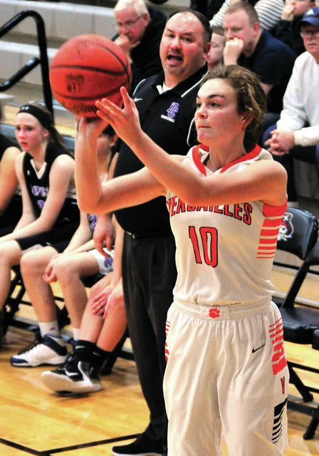 Versailles Kami McEldowney shoots a 3-pointer during a Division III sectional final on Tuesday at Covington.