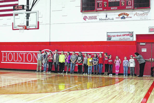 """Tina Mertz, high school and junior high math teacher, speaks to the group of elementary students, each of whom was recognized on Friday for academic excellence during the """"All As"""" presentation in the Hardin-Houston School gym."""