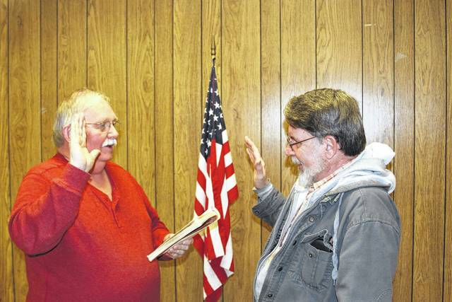Port Jefferson Mayor Steve Butterfield swears in councilman David Clem during Monday night's meeting.