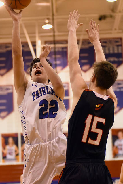 Fairlawn freshman guard Ashton Piper shoots with pressure from Triad's Andrew O'Neal during a Division IV sectional quarterfinal on Friday at Piqua's Garbry Gymnasium.