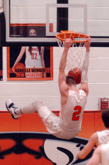 Versailles senior forward Justin Ahrens dunks during a nonconference game on Saturday.