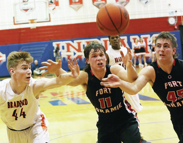 Bradford's Clay Layman, left, Fort Loramie's Nick Brandewie, center, and Austin Siegel at Piqua chase after a loose ball in a Division IV sectional semifinal on Wednesday at Piqua's Garbry Gymnasium.