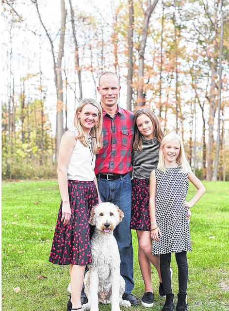 Jessica, Doug, Kaitlyn and Brooklyn Fortkamp, along with their dog Max, have established the .