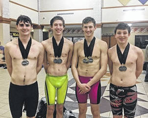 The Sidney boys Relay Team of Caleb Johnson, Collin McClain, Chase VanTilburgh and Jaden Humphrey poses after finishing second in the 200 Medley and the 200 Free Relay in the GWOC American League race on Jan. 27.