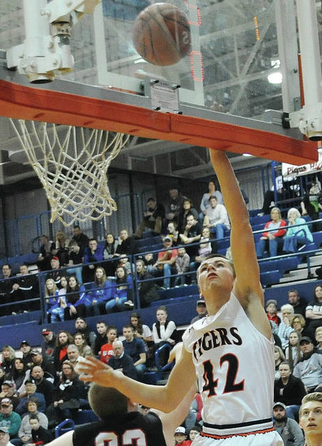 Jackson Center's Calvin Winner shoots as Mississinawa Valley's D.J. Howell defends during a Division IV sectional quarterfinal at Piqua on Friday.