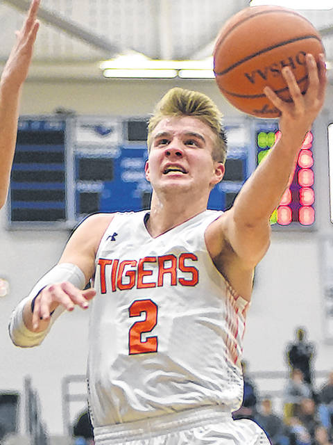 Versailles' Justin Ahrens shoots during a game against Sidney in Flyin' to the Hoop on Jan. 15. Versailles is ranked No. 6 in this week's Associated Press state poll.
