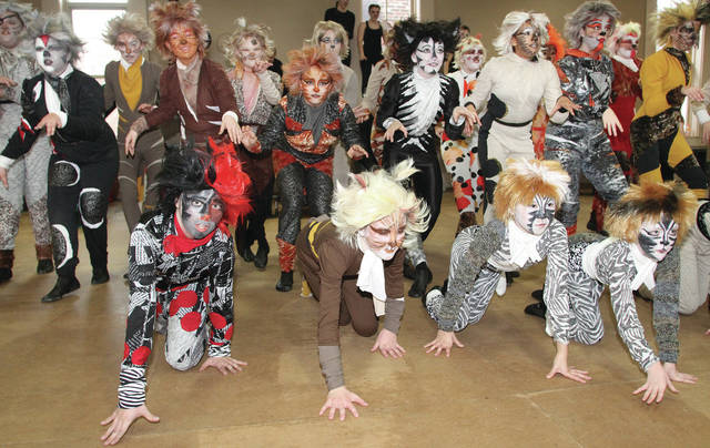 """Members of the cast of """"Cats"""" perform a dress rehearsal, recently."""