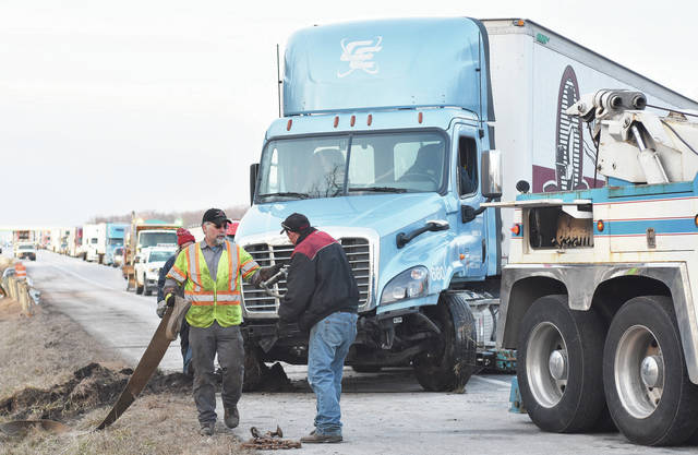 A semitrailer is towed out of the ditch where it crashed in the south bound lane of I-75 just south of exit 102. Traffic was backed up for miles until the truck was finally freed at around 5:30 p.m., Wednesday, Jan. 31.
