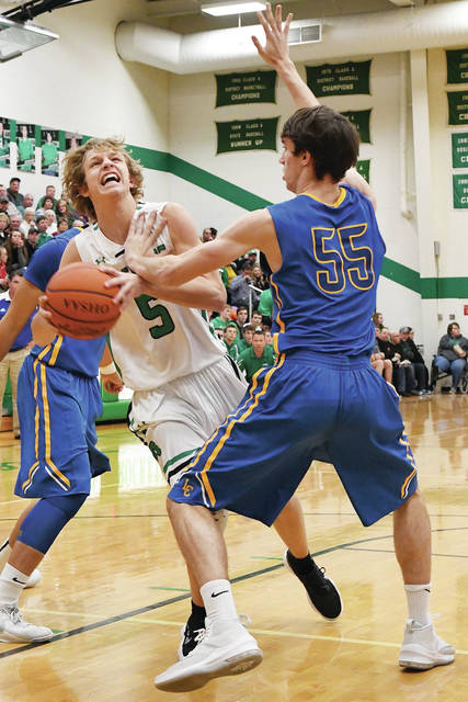 Anna's Wyatt Bensman drives past Lehman Catholic's Conor O'Leary during at nonconference game on Friday at Anna.