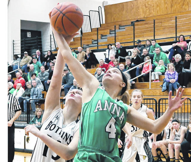 Anna's Taylor Kauffman fights for a rebound with Botkins' Paige Lane last Saturday. Anna is the No. 6 seed in the Dayton Div. III sectional, while Botkins is No. 4 in the Sidney D-IV sectional.