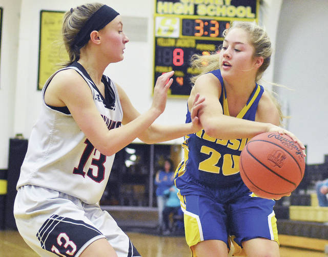 Russia's Ashley Scott passes while Mississinawa Valley's Riley Price defends during a Division IV sectional semifinal on Tuesday at Sidney.
