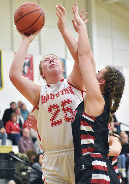 Houston's Jess Monnier shoots as Triad's Audrey Lightle defends during a Division IV sectional semifinal on Wednesday at Sidney.