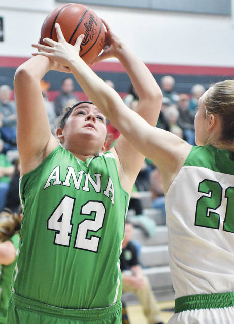 Anna's Emily Aufderhaar shoots with pressure from Bethel's Alaina Hawthorn on Thursday at Covington.
