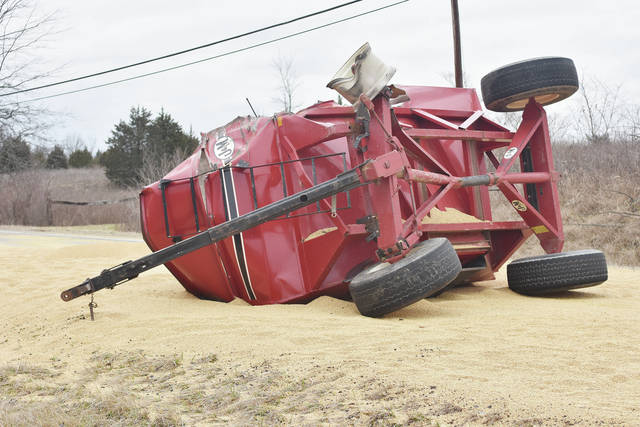 Soybeans cover state Route 66 following a crash, Thursday, Feb. 22.